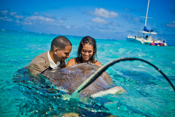 adventure wedding photography Stingray City, Grand Cayman Trash the Dress