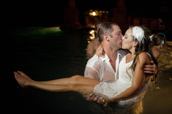 jump in the pool wedding photos Costa Rica Destination Wedding at Zephyr Palace