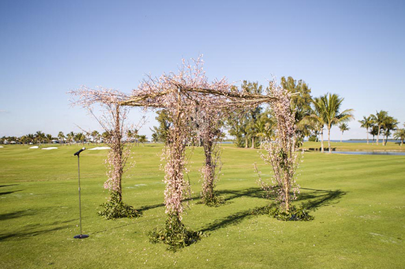 ceremony cherry blossom structure Tented Destination I Do in Florida