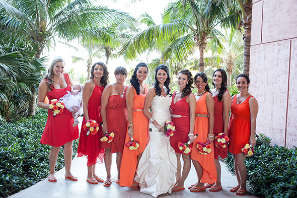 orange bridesmaid dresses A Brightly Colored Beach Wedding in the Bahamas