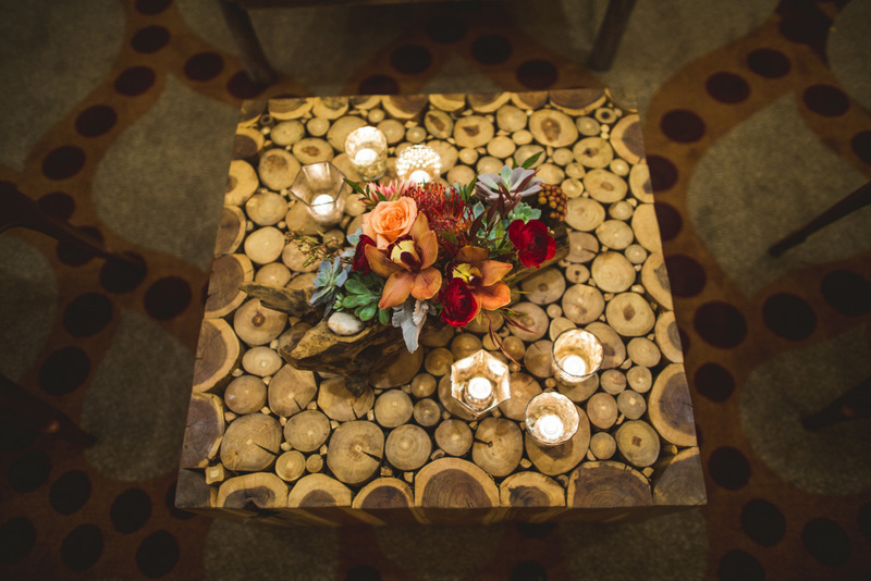 Red, Orange, & Wood Centerpiece; Wood Coffee Table